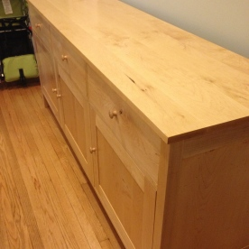 Maple sideboard with hidden wine rack.