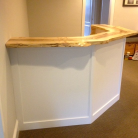 Reception desk with live edge maple top.
