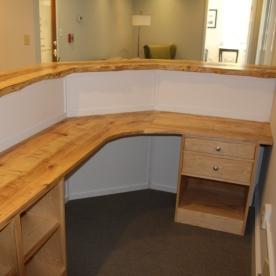 Reception desk with live edge maple top.
