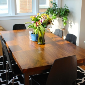 Walnut dining table with custom steel base.