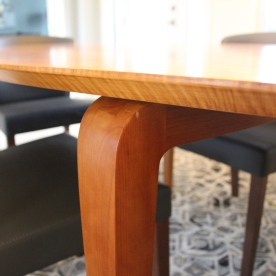 Tiger maple table top with cherry legs.